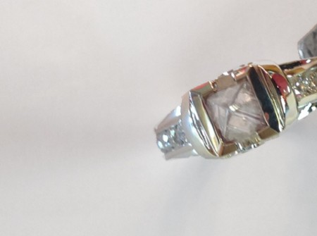 This view shows the big diamond in the wedding anniversary ring made of 14k white gold