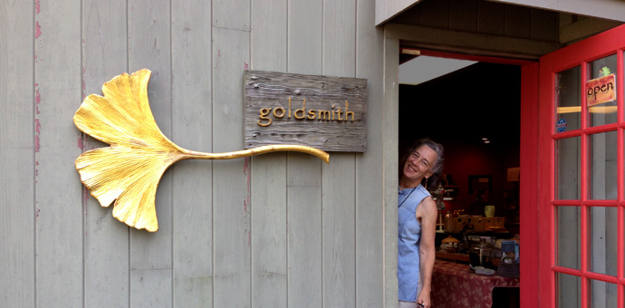 Raimie Weber jeweler smiling from the shop's door