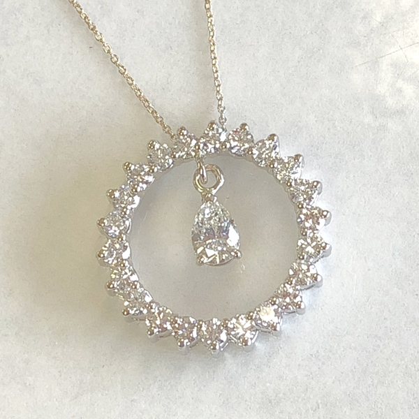 altered pendant has pear-shaped diamond hanging freely from the eternity circle