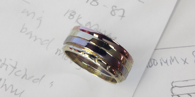 4 rings are stacked and design includes original wedding band