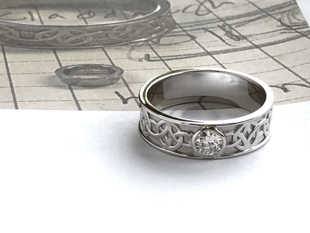 finished Celtic pattern ring and Raimie's design sketches