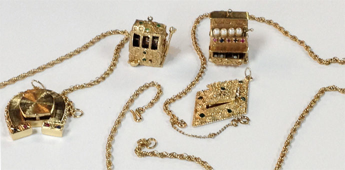 oversized charms removed from bracelet - horseshoe, cash register, carriage, ace of diamonds