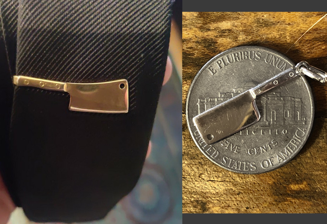 his favorite tie bar and the charm used for fabrication (compared to nickel size)