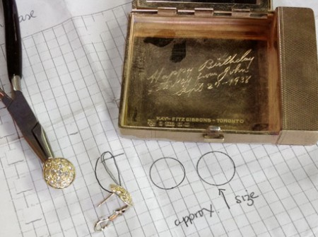 Clip earring shown next to compact used