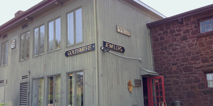 Wood shop exterior with Jeweler and Goldsmith signs