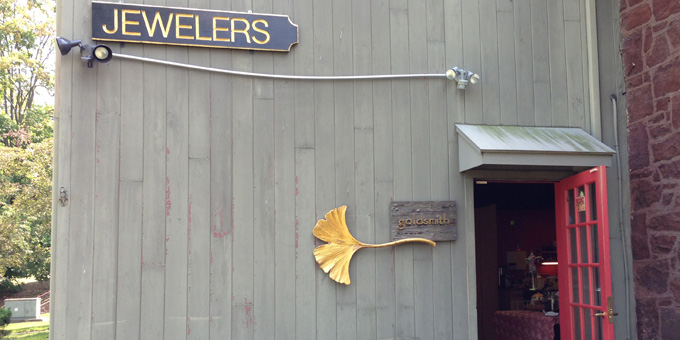 Jewelers sign, gingko leaf next to doorway