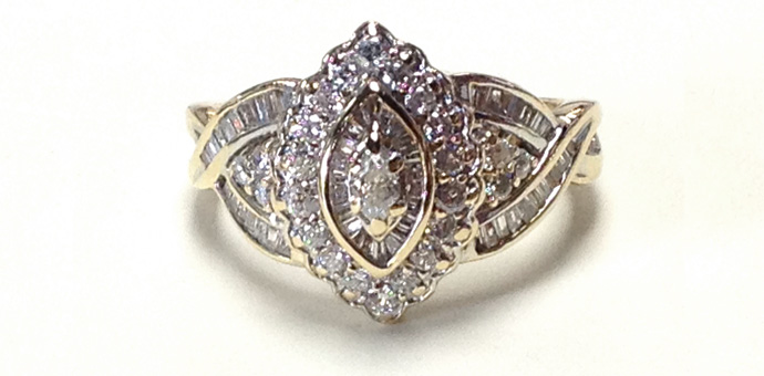 front of repaired ring has marquise cut, baguette cut, and full round diamonds