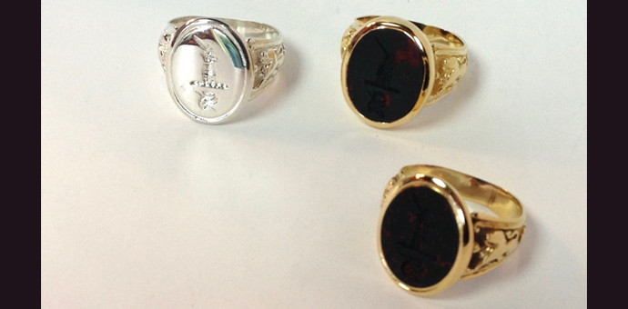 side view of old and new recreated bloodstone slater crest rings