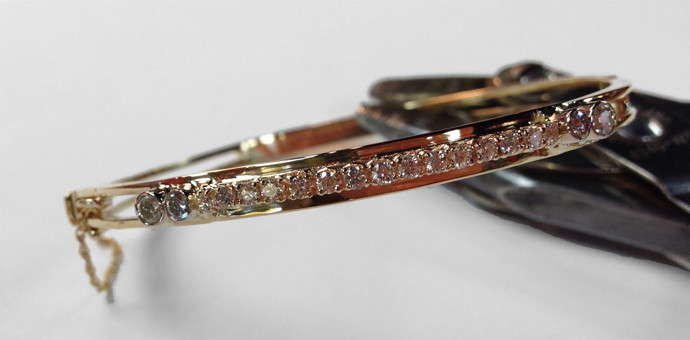 The finished customization of this diamond bangle bracelet with diamonds added and new setting