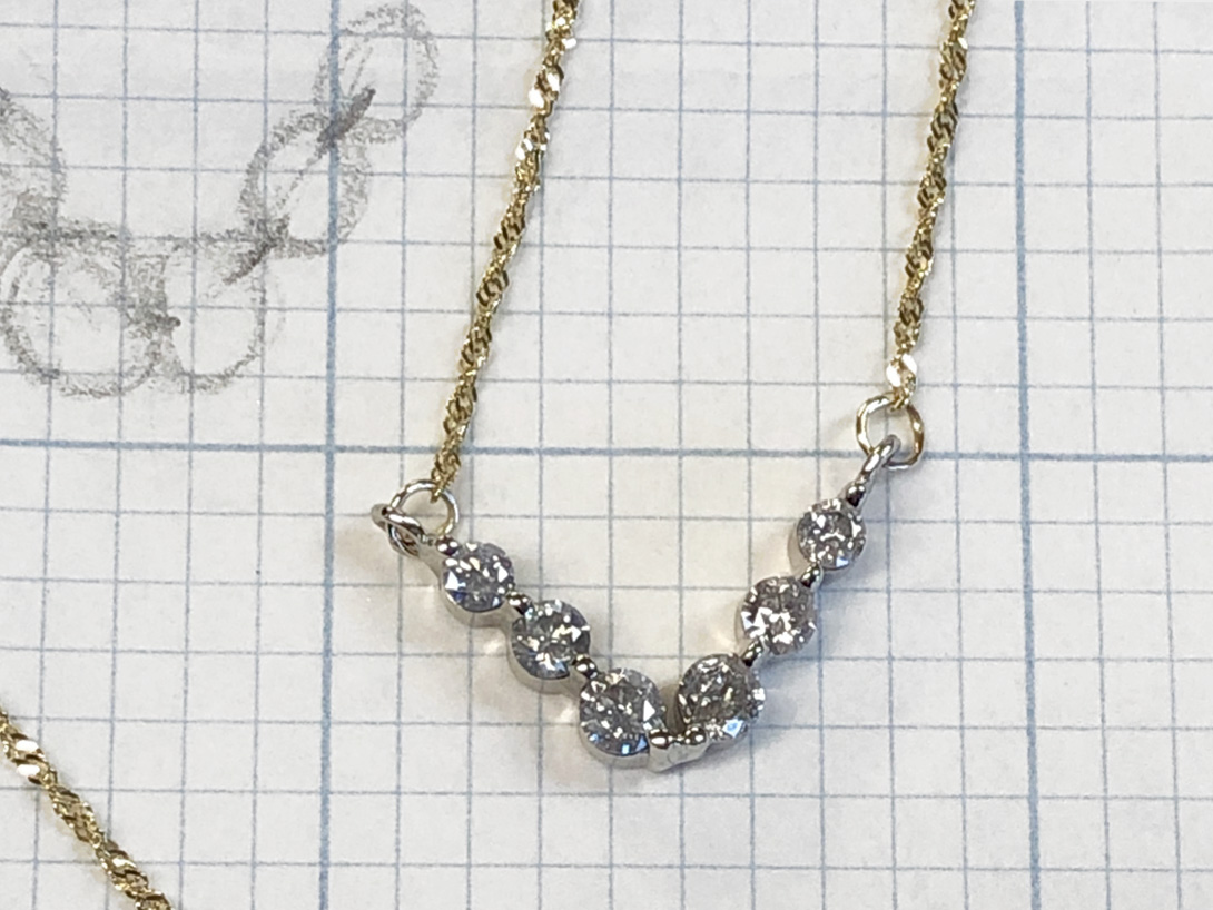 diamond chevron necklace has free movement due to link design