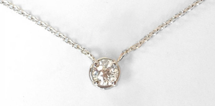 finished sweet solitaire necklace made from reset family diamond