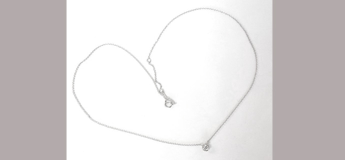 sweet solitaire pendant shows with full chain
