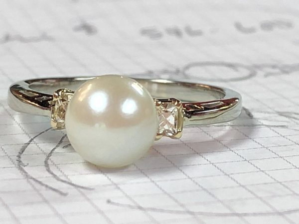 ring made from stud earrings and a solitaire pearl pendant