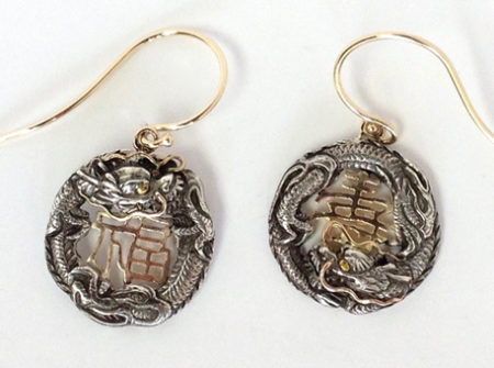 the center of these earrings has a chinese symbol. redesigned jewelry