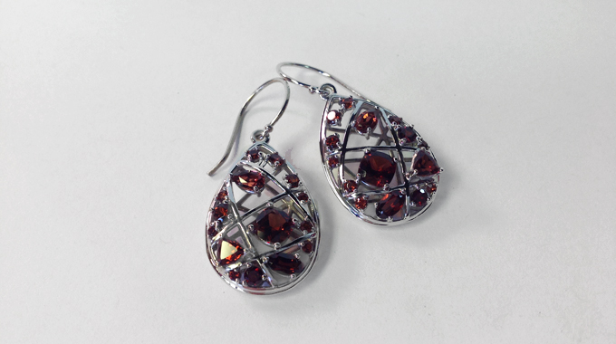 earrings have teardrop shap studded with Mozambique diamonds of various sizes and shapes
