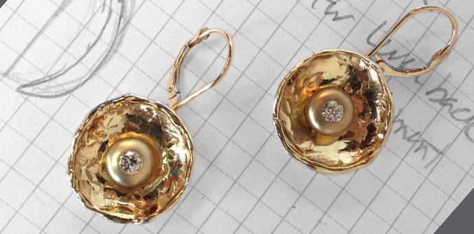 gold and diamond earrings created from her old bits of jewelry