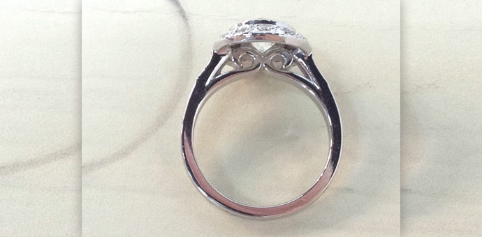 side view of edwardian style engagement ring with platinum halo