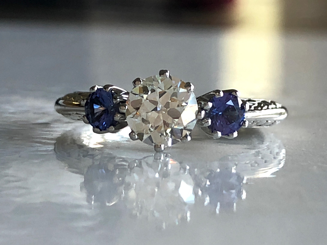 diamond from family brooch heirloom at the center of the new engagement ring