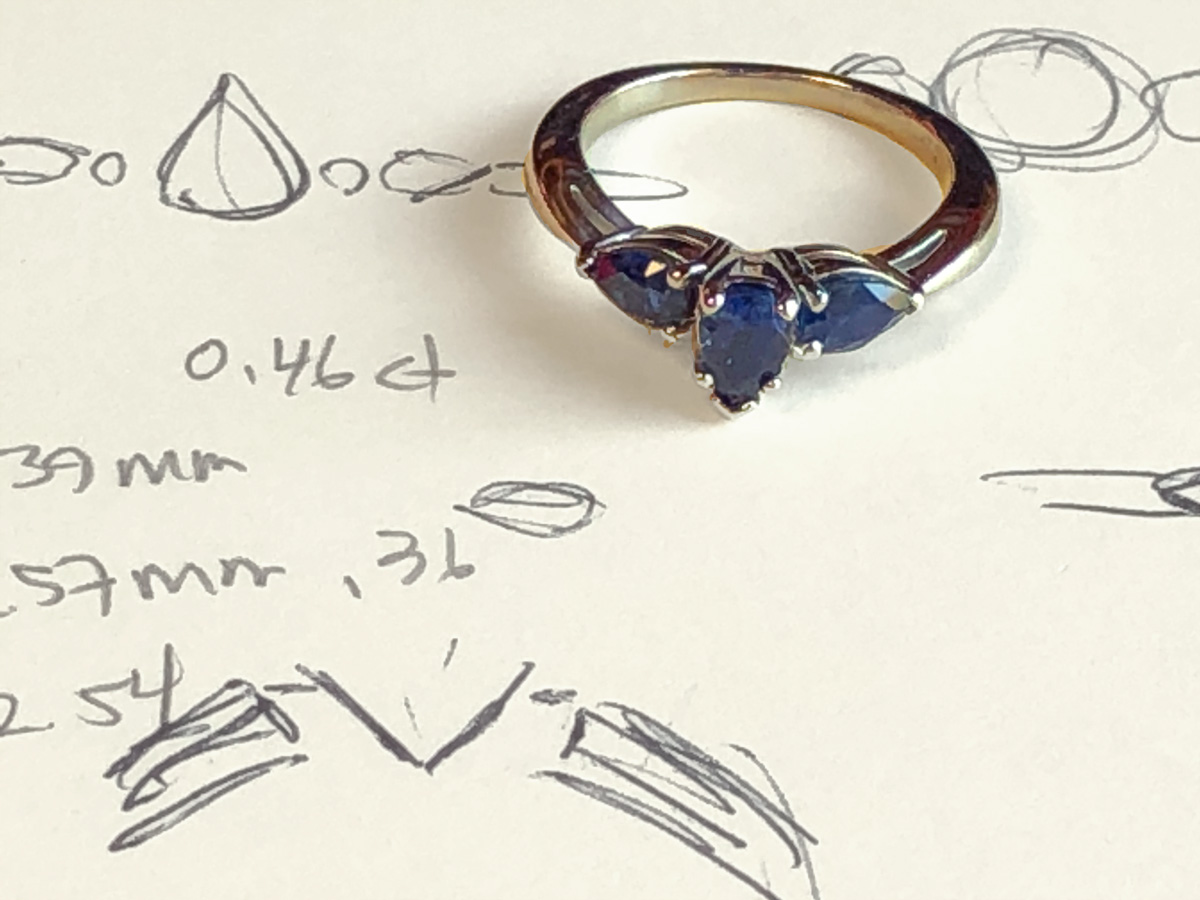 sapphire engagement ring with design notes