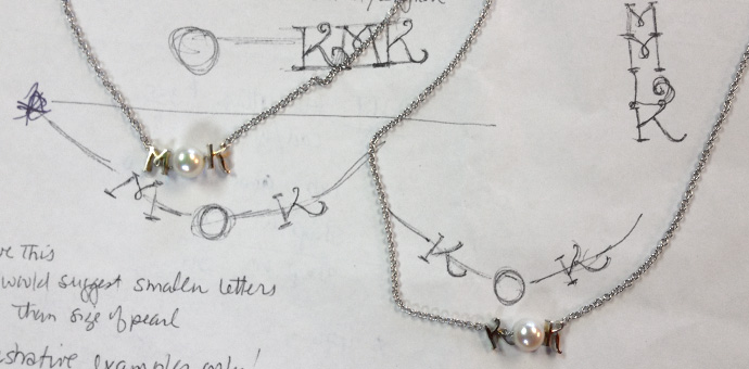 Necklaces have initials of wearers KOK and MOK with nice pearl center