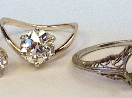 vintage family ring next to updated engagement ring