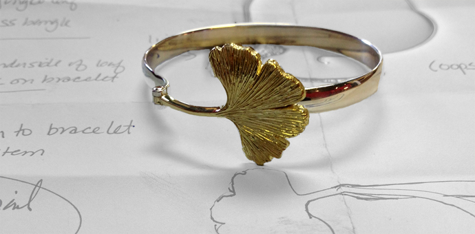 18k green gold, sterling silver. hinged gingko bracelet shown over drawings