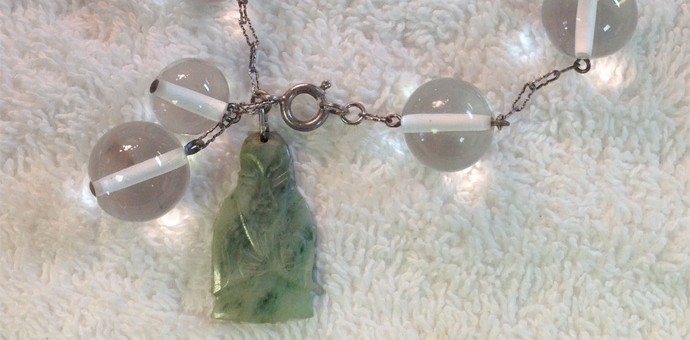 Close up of jadeite Buddah dangle