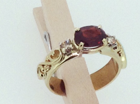 Gold ring with garnets made from