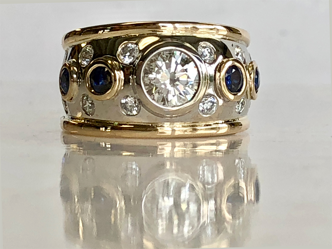 A grown up ring with many diamonds and sapphire