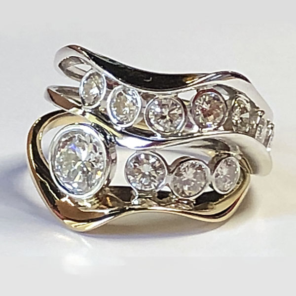 Healing ring. Redesigned wedding set is diamond wave ring