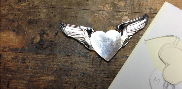 draft of silver heart to be incorporated with airman squadron wings - drawings nearby