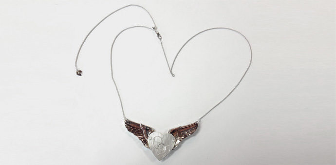 the full view of pendant on silver chain - heart wings pendant necklace with heart tag
