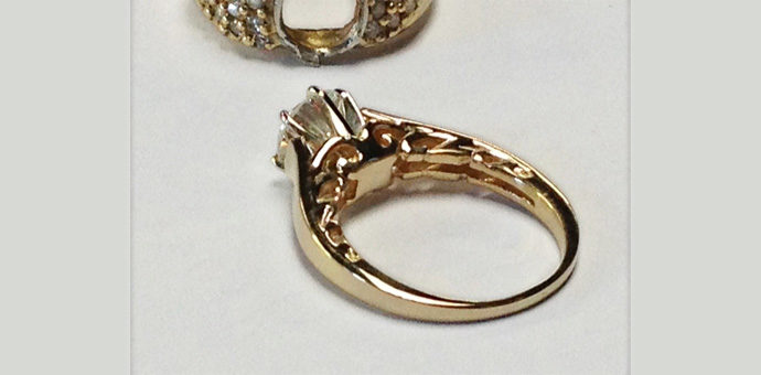 solitaire engagement ring pictured with back view of under carriage scrollwork