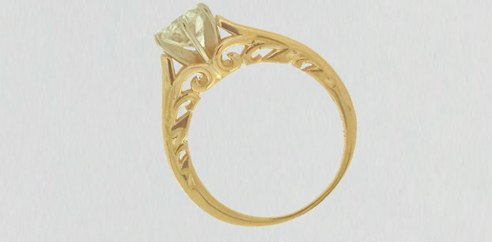 side view of engagement ring shows off scroll work around diamond