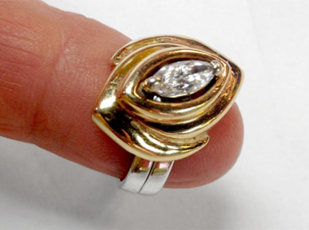 final ring marquise diamond in gold setting with sterling band