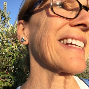selfie of jewelry customer - wearing custom platinum posts with white and black diamonds gingko motif