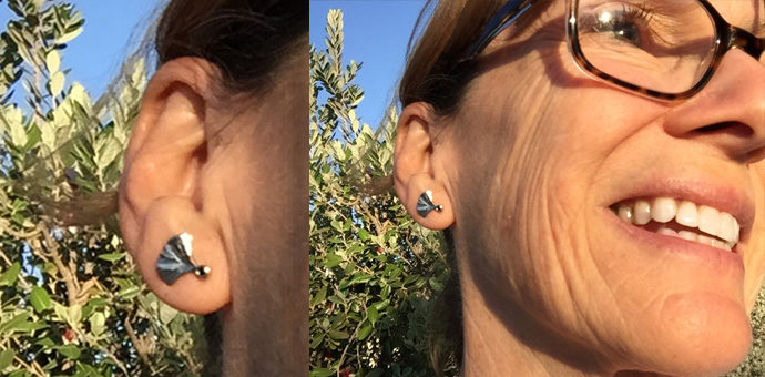 happy owner wearing gingko earrings