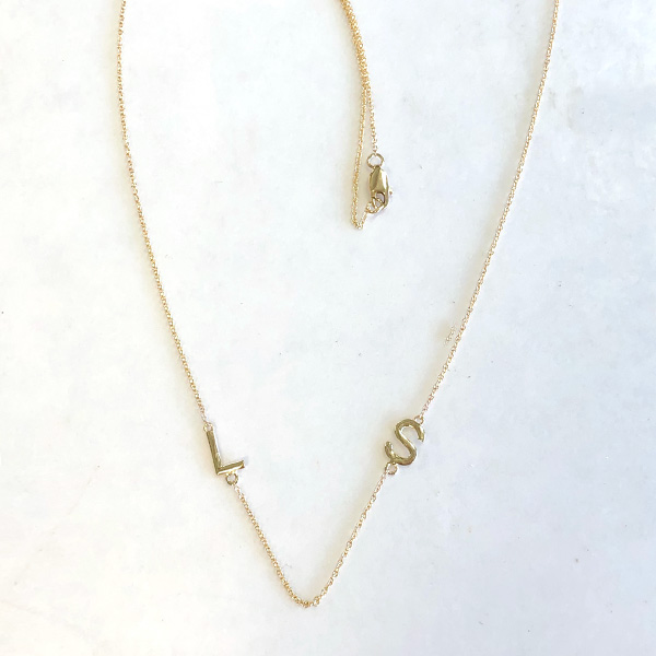 gold necklace with L and S initials on chain