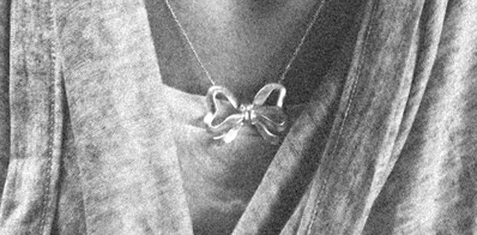 necklace shown being worn on very happy gift recipient
