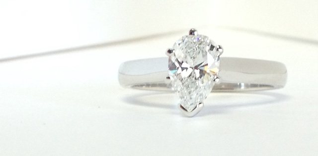 classic engagement ring with solitaire pear-shaped diamond