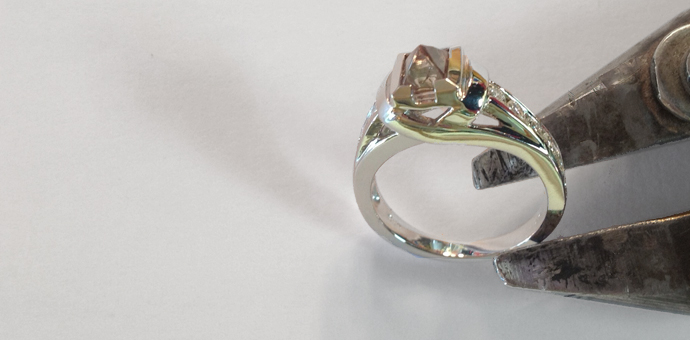 Octahedron diamond ring with smaller diamonds representing children, customized and beautiful and made in Connecticut