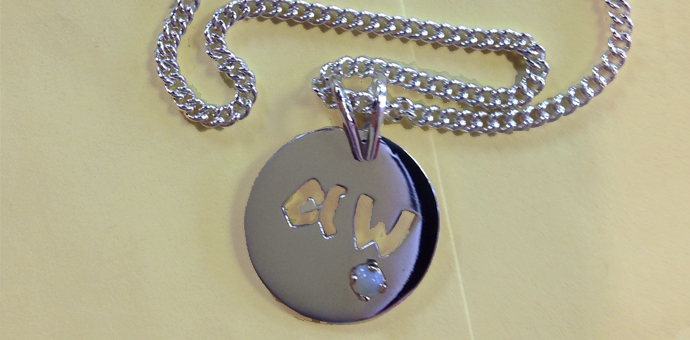silver pendant the initials goes right through and a nice little opal finishes it off