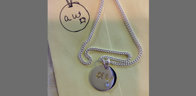 pendant shown with drawing on table - sterling silver - made in New England, Connecticut
