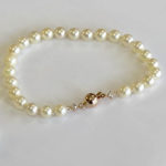 pearl bracelet with rose gold bead clasp