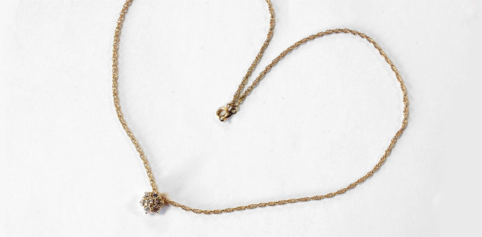 full view of necklace with diamond cluster pendant