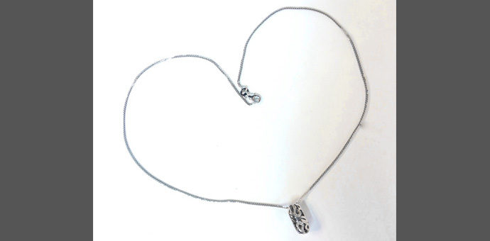 pendand view of you & me engraved pendant necklace twists into a heart, wheat link chain, designed by Elma Go;