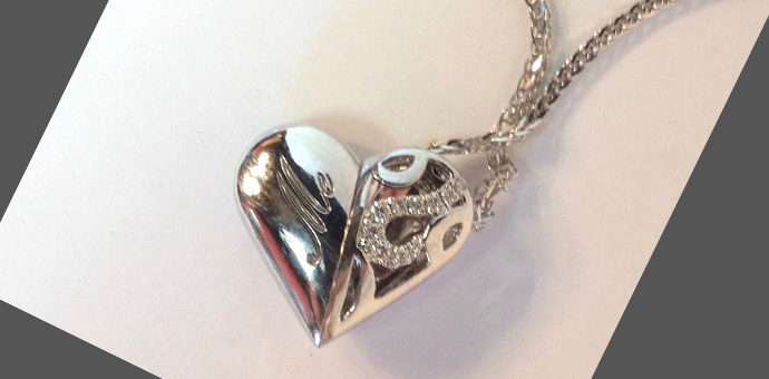 "close up view of ""me"" engraving - heart configuration"