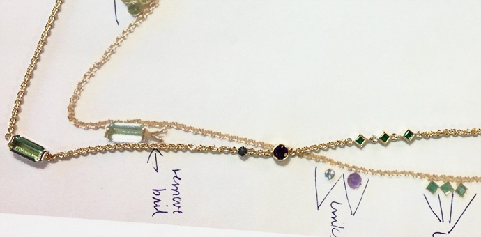 necklace layout with design notes for gem placement emerald, aquamarine, and peridot