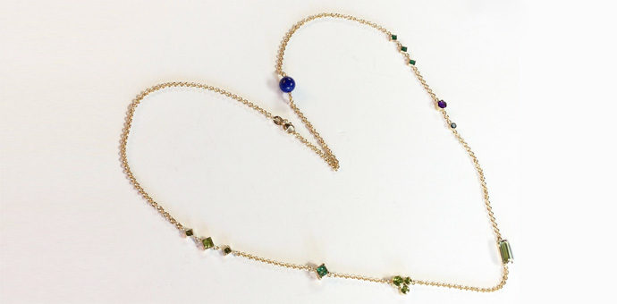 necklace with gems said to have great powers lapis lazuli, emerald, aquamarine, and peridot
