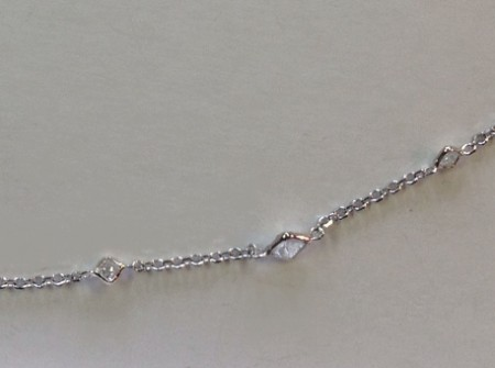 Several princess cut diamonds, very delicate necklace